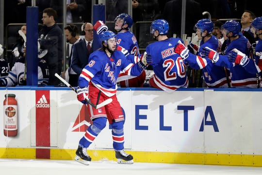 Oct 3, 2019; New York, NY, USA; New York Rangers center Mika Zibanejad (93) celebrates scoring a goal during the third period against the Winnipeg Jets at Madison Square Garden.
