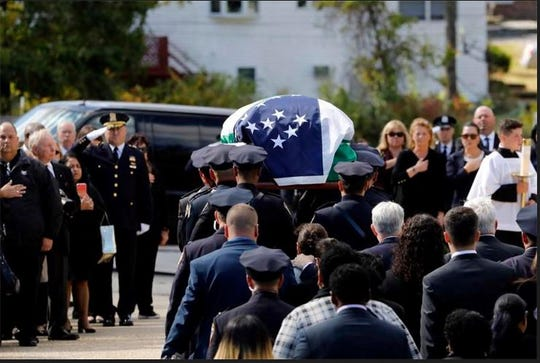 The casket bearing New York City Police Officer Brian Mulkeen is carried into Church of the Sacred Heart, Friday, Oct. 4, 2019, in Monroe, New York. Authorities say Mulkeen, who grew up in Orange County, New York, and lived in Yorktown Heights, New York, was fatally hit Sunday by two police bullets while struggling with an armed man in the Bronx. He is the second New York City officer killed by friendly fire in 2019.