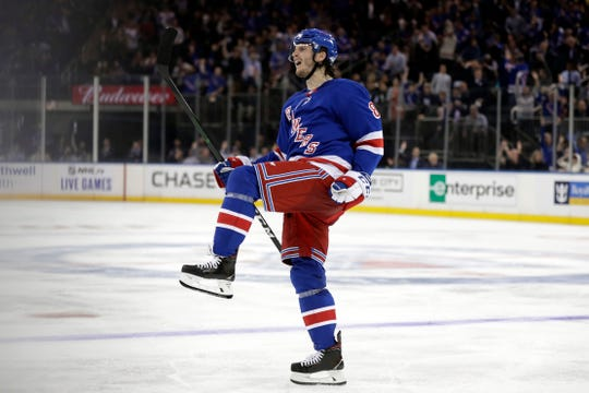 Oct 3, 2019; New York, NY, USA; New York Rangers defenseman Jacob Trouba (8) celebrates scoring a goal during the second period against the Winnipeg Jets at Madison Square Garden.