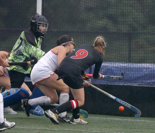 Kate Stevens of Rye scores on Whiite Plains goalie Meaghan Furry during a varsity field hockey game at White Plains High School Oct. 3, 2019. Rye defeated White Plains 3-0.