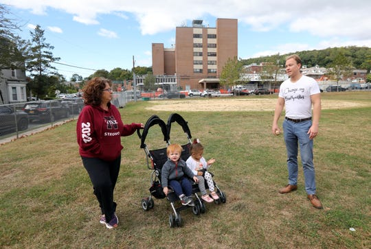 Nyack resident Justin Machia chats with his neighbor Tina Guarasci, who runs a daycare on Haven Court, at MacCalman Field in Nyack Oct. 4, 2019. They are trying to save the park, which is used by several community groups, from being turned into a parking lot by Montefiore Nyack Hospital.
