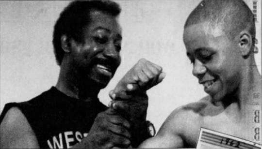 Lennell Shepherd pictured (left) in the May 28, 1998 edition of The News Journal. Shepherd made the Guinness Book of Records in 1970 after tearing three phone books in half and spearing his hand through another.