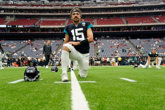 Jacksonville Jaguars quarterback Gardner Minshew (15) warms up before an NFL football game against the Houston Texans Sunday, Sept. 15, 2019, in Houston. (AP Photo/David J. Phillip)