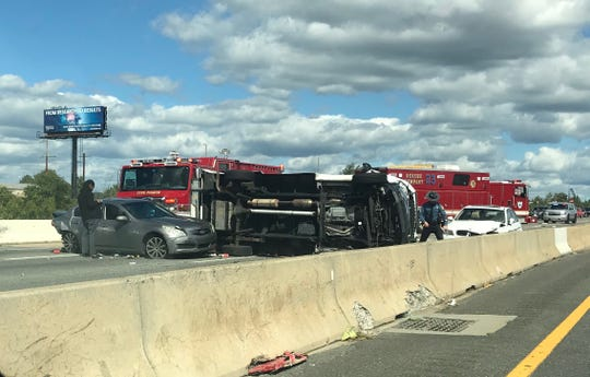A three-vehicle wreck closed Interstate 95 near the Christiana River bridge Friday afternoon.