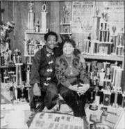 Lennell Shepherd and his first wife, Marilyn, in their New Castle area home with some of his weightlifting memorabilia in 1992.