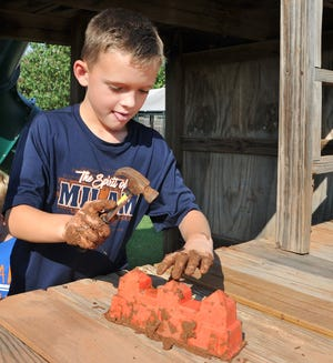 Koltin McCutcheon, 7, has big dreams for a little bit of mud. His goal is to build a house made from bricks that he plans to make out of dirt dredged from Lake Wichita.