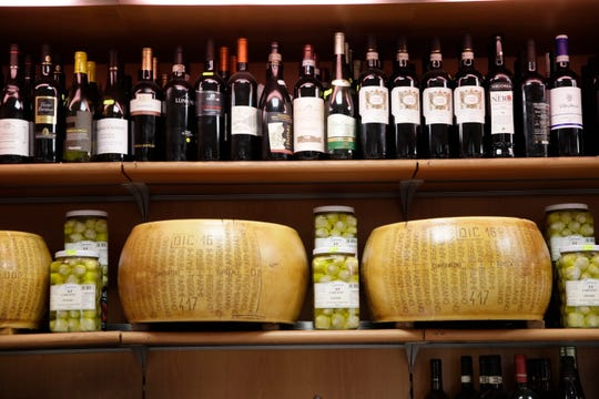 Wheels of parmesan cheese are on sale with spirits in a deli in Rome. The U.S. had prepared for Wednesday's ruling and already drawn up lists of the dozens of goods it would put tariffs on. They include EU cheeses, olives, and whiskey, as well as planes, helicopters and aircraft parts in the case, though the decision is likely to require fine-tuning of that list if the Trump administration agrees to go for the tariffs.