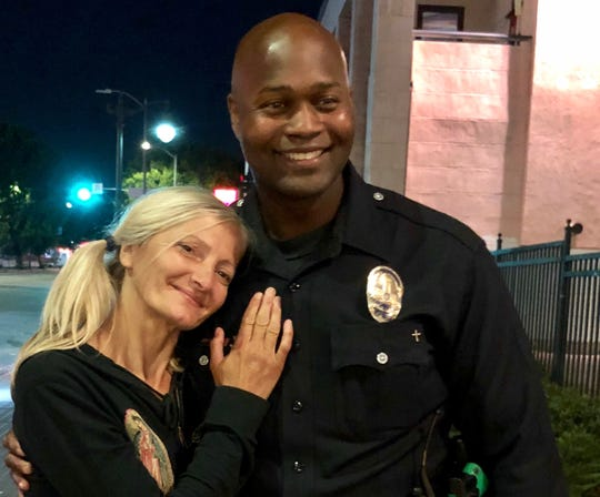 Emily Zamourka stands next to LAPD officer Alex Frazier, whose impromptu video of the homeless woman singing has caused an outpouring of support.