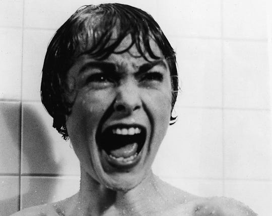 "Janet Leigh screams in the shower in the famous scene from the film ""Psycho."""