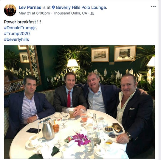 This Facebook screen shot provided by the Campaign Legal Center shows, from left, Donald Trump Jr., Tommy Hicks, Lev Parnas and Igor Fruman.