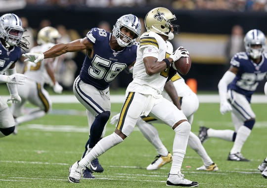 Dallas Cowboys defensive end Robert Quinn (58) closes in for a sack on New Orleans Saints quarterback Teddy Bridgewater.