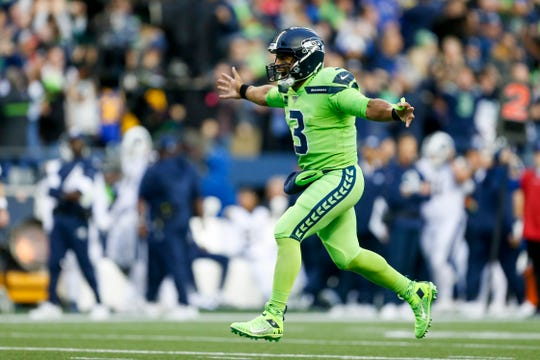 Seattle Seahawks quarterback Russell Wilson (3) celebrates after throwing a touchdown pass against the Los Angeles Rams during the second quarter at CenturyLink Field.