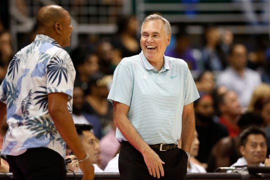 Los Angeles Clippers' head coach Doc Rivers, left, and Houston Rockets' head coach Mike D'Antoni talk on the sidelines during the second quarter of an NBA preseason basketball game, Thursday, Oct 3, 2019, in Honolulu.
