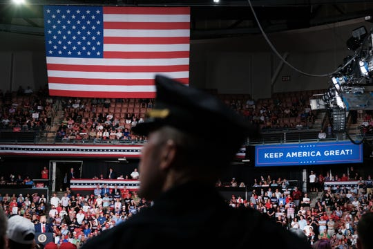 A police officer stands guard as President Donald Trump speaks to supporters at an evening rally on August 15, 2019 in Manchester, New Hampshire.
