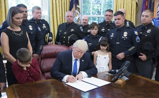 President Donald Trump indicators a proclamation supporting police officers on the White Dwelling on Could maybe 15, 2017 in Washington, DC.