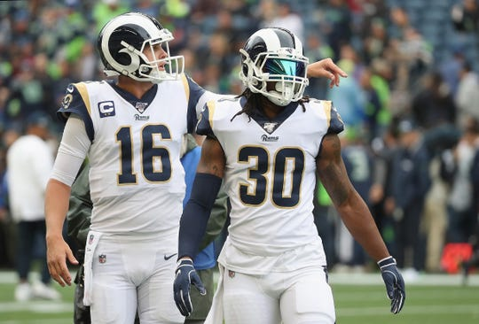 Quarterback Jared Goff and running back Todd Gurley of the Los Angeles Rams warm up before the game against the Seattle Seahawks at CenturyLink Field on October 03, 2019, in Seattle, Washington.
