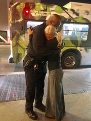 LAPD officer Alex Frazier embraces Emily Zamourka, a woman who lives on the streets of Los Angeles. His viral video of Zamourka singing an Italian aria in a subway station has resulted in a flood of kindness for the musician.