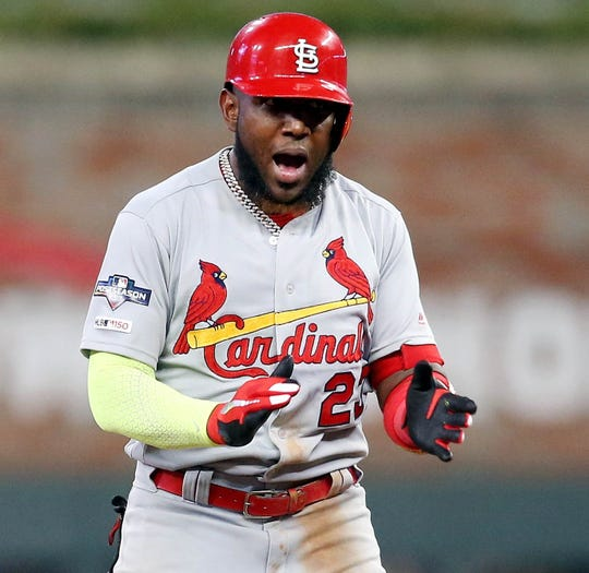 Marcell Ozuna celebrates after hitting a two-run RBI double in the ninth inning.