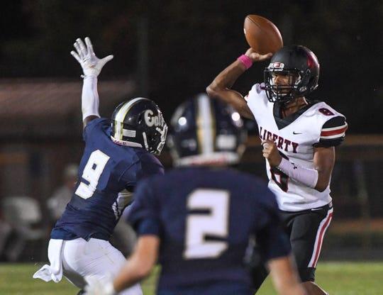 Liberty junior EJ Stafford(8) throws near Seneca senior Elijah Cobb(9) during the first quarter at Seneca High School in Seneca Friday, October 4, 2019.