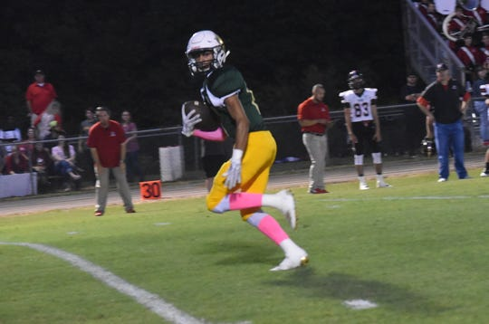 Holy Savior Menard's Dru Scully sprints for a touchdown hosted Many High School Friday, Oct. 4, 2019. Many won 52-31.