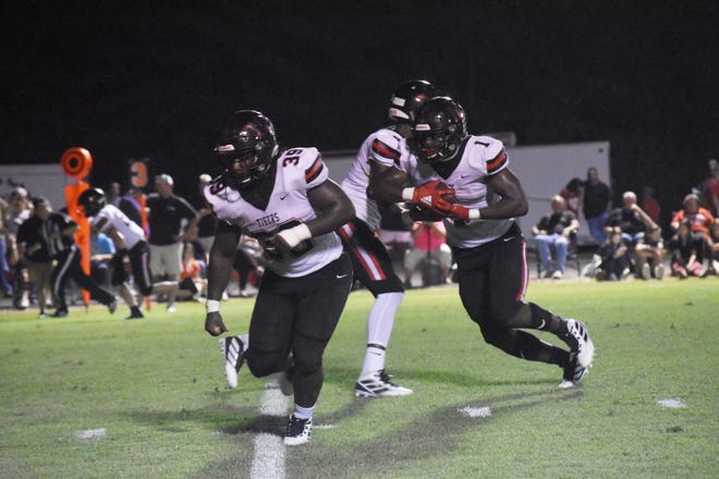 Many running backs Terrence Williams (1) and Shamarion Wiseman (39) had big games Friday, Oct. 4, 2019 against Menard.