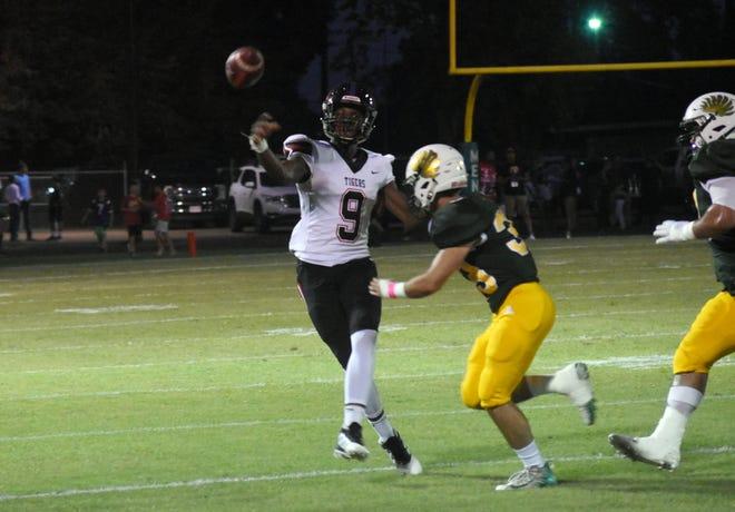 Menard's Andrew Lemoine tries to get the sack on Many quarterback Cadillac Rhone Friday, Oct. 4, 2019.
