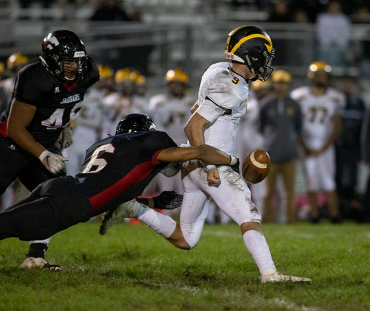 Jackson Memorial Tyronn Blackwell strips the ball from CJ Duell during second half action. St John Vianney football vs Jackson Memorial on October 4, 2019 in Jackson, NJ.