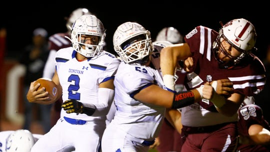 Donovan Catholic's Quarteback Ryan Clark gets help clearing a way to the endzone during the game against Red Bank Regional in Little Silver Friday night, October 4, 2019.
