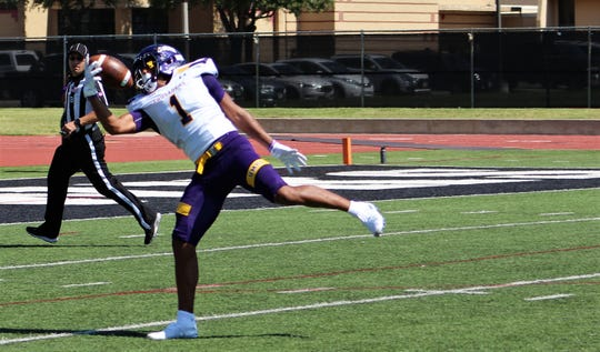 Wide open, Brenton Martin makes a one-handed catch and tumbles toward the end zone to score Mary Hardin-Baylor's second touchdown on their second offensive play against McMurry on Saturday at Wilford Moore Stadium.