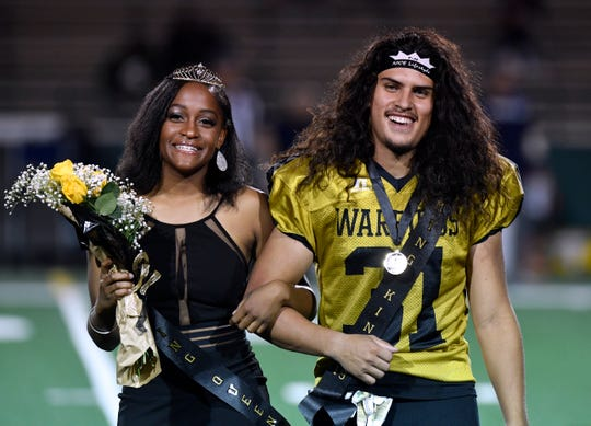 Jorge Hernandez, right, basks in being named homecoming king during halftime of a football game Oct. 4. He shared the moment with homecoming queen Tavia Wilson. They'll both be among Abilene High's graduating class, which celebrates virtually at 11 a.m. Saturday.