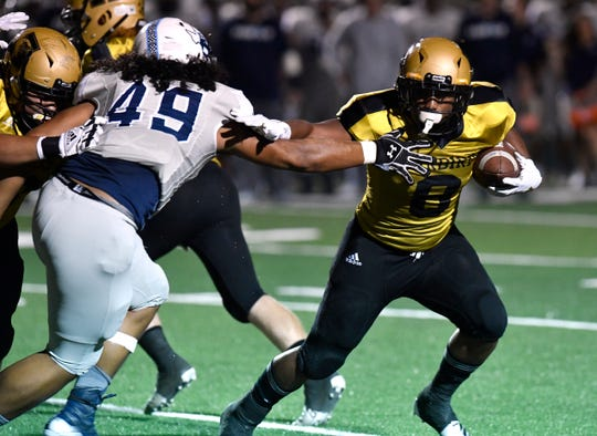 Eagles running back Phonzo Dotson pushes Blue Raiders defensive end Peter Lilomaiava during Friday's homecoming game between Abilene High and L.D. Bell at Shotwell Stadium Oct. 4, 2019. Final score was 13-0, Abilene High.
