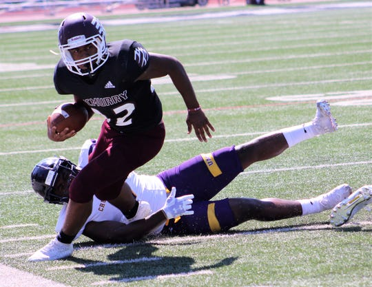 McMurry's Dee Robinson plans to stay inbounds after taking a short pass in the first half and evading one Mary-Hardin-Baylor tackler. He rushed for 15 yards and caught two passes in the War Hawks' 79-0 loss Saturday.
