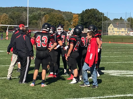 Newark Valley players gather during a timeout in Saturday's Section 4 Football Conference Division III game against visiting Spencer-Van Etten/Candor. The Cardinals won, 33-6.