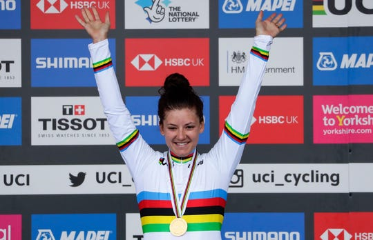 United States' Chloe Dygert, who lives and trains in Kitsap, celebrates on the podium after winning the women's elite individual time trial event, at the road cycling World Championships in Harrogate, England, on Sept. 24, 2019.