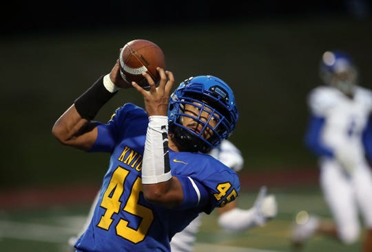 Bremerton's Kaipo Retome (45) pulls down a catch against North Mason on Friday, Oct. 4, 2019.