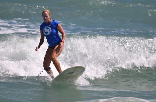 Joy Anderson in the 30-59 women's longboard competition. Scenes from the Salty Sweet Surf Contest at Minutemen Causeway Saturday in Cocoa Beach.