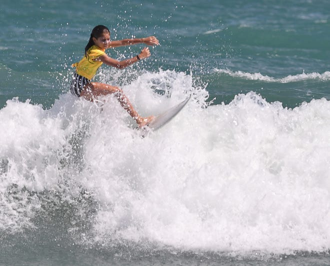 Kora Passarelli, seen here in 2019, won the Girls U-14 Shortboard competition at the Eastern Surfing Association's Southeast Regionals in Indialantic this past weekend, and she was joined on the podium by her dad, Anthony, after he won the Legends division.