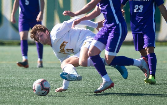 Vermont's Alex Nagy tries to win the ball back from the ground against Albany during a men's soccer game at Virtue Field on Saturday, Oct. 5, 2019.
