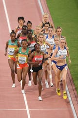 Hellen Obiri of Kenya leads the pack in the Women's 5000 Metres final during day nine of 17th IAAF World Athletics Championships Doha 2019 at Khalifa International Stadium on October 05, 2019 in Doha, Qatar.