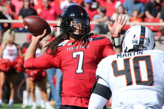 Oct 5, 2019; Lubbock, TX, USA; Texas Tech Red Raiders quarterback Jett Duffey (7) drops back to pass against Oklahoma State Cowboys defensive end Brock Martin (40) in the first half at Jones AT&T Stadium. Mandatory Credit: Michael C. Johnson-USA TODAY Sports