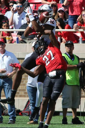 Texas Tech cornerback Alex Hogan (27) made his college debut last year against Oklahoma State and broke up a pass for Cowboys wide receiver Jordan McCray. Hogan has played in 13 games for the Red Raiders and started three.