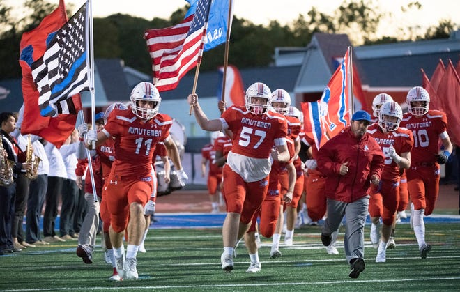 The Washington Township High School football team enters the field prior to the game between Washington Township and Egg Harbor Township, played at Washington Township High School on Friday, October 4, 2019.
