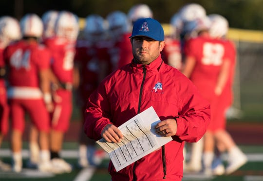 Washington Township High School football coach Mike Schatzman takes to the field prior to the game between Washington Township and Egg Harbor Township, played at Washington Township High School on Friday, October 4, 2019.