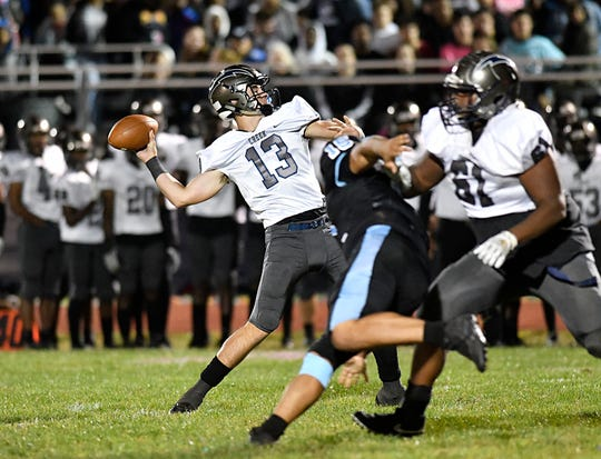 Timber Creek quarterback Donovan Leary throws for a completion during Friday night's football game against Highland on Oct. 4, 2019.