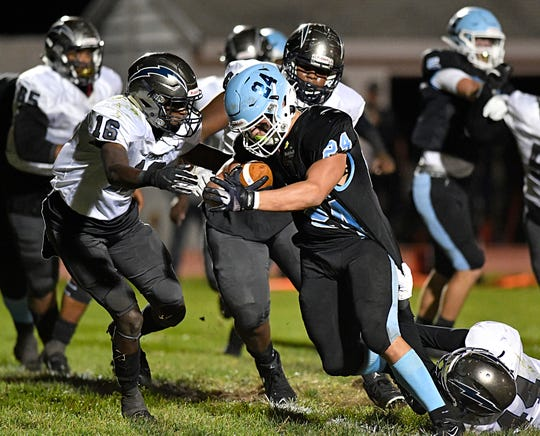 Highland's Mike D'amico runs for a gain during Friday night's football game against visiting Timber Creek. The Tartans defeated the Chargers, 21-17, at Highland Regional on Oct. 4, 2019.