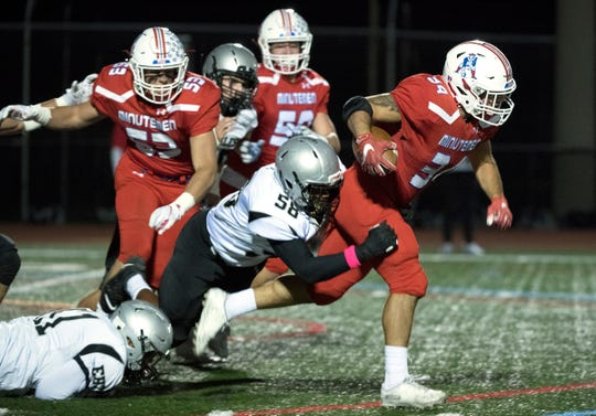 Washington Township's Andrew Nocille runs the ball as Egg Harbor Township's Stephen Moore Jr. makes the tackle during the 1st quarter of the football game played at Washington Township High School on Friday, October 4, 2019.
