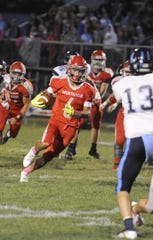 Westfall's Trenton Davis runs the ball during a 36-20 loss to Adena on Friday, Oct. 4, 2019 at Westfall High School in Williamsport, Ohio.