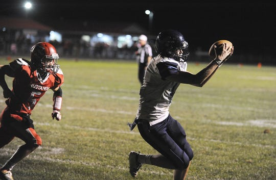Adena wide receiver Logan Bennett catches a pass during a 36-20 win over Westfall on Friday, Oct. 4, 2019 at Westfall High School in Williamsport, Ohio.