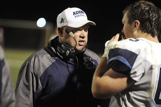 Adena head coach John Penwell talks to Eric Hurtt during a 36-20 win over Westfall on Friday, Oct. 4, 2019 at Westfall High School in Williamsport, Ohio. Penwell brought the idea to raise money for the Adena Cancer Center to his captains in October as the team ultimately raised over $200.