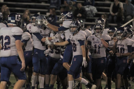 Conner players celebrate their win over Highlands.